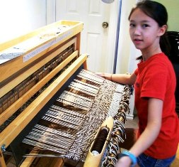 Sarah weaving on floor loom