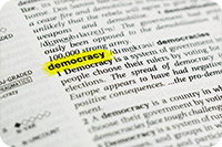 """The word """"democracy"""" highlighted in the dictionary (iStockphoto)"""