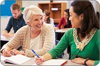 Adult student and teacher (iStockphoto)