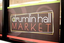 New Drumlin Hall Market Logo on Window