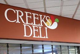 New Creeks Deli Logo - Drumlin Hall - DCC