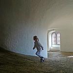 A girl runs the spiral in Copenhagen