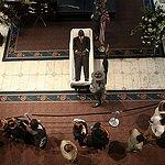 Rev. Pinckney lies in a casket
