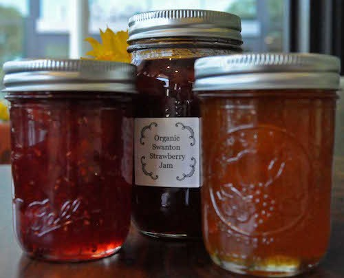 Jars of jam, including jam made from organic Swanton strawberries from Costanoa Commons farm.