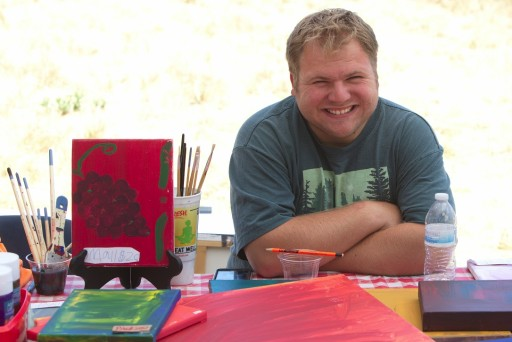 Dylan Flint selling his paintings to benefit Costanoa Commons.
