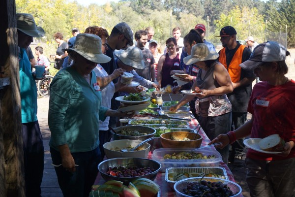 Volunteers line up for a delicious lunch after a morning of hard work.