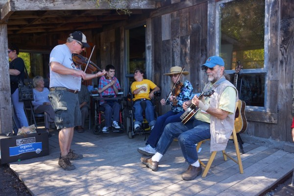 Two fiddles and a banjo give us something else to enjoy on a beautiful and productive day at the farm.