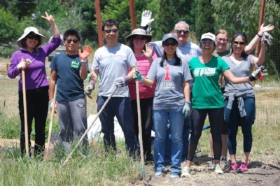 Volunteers from Gilead Sciences, Inc. pose after working on the farm on a June weekend.