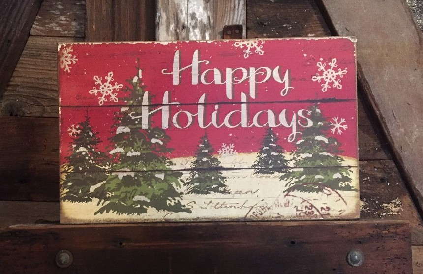 """An old-fashioned sign that says, """"Happy Holidays."""""""