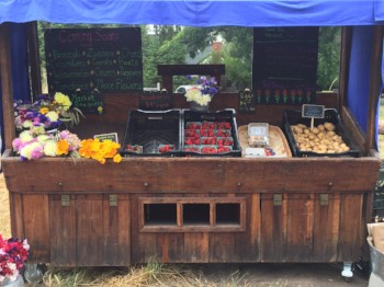 The farm stand is stocked and ready for customers.