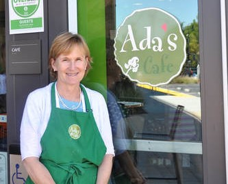 Kathleen Foley-Hughes poses in front of Ada's Cafe.
