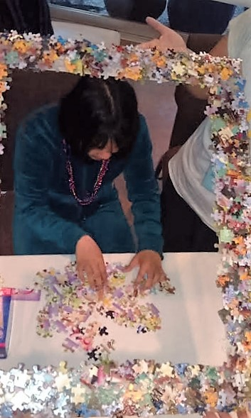 Angela working on a puzzle