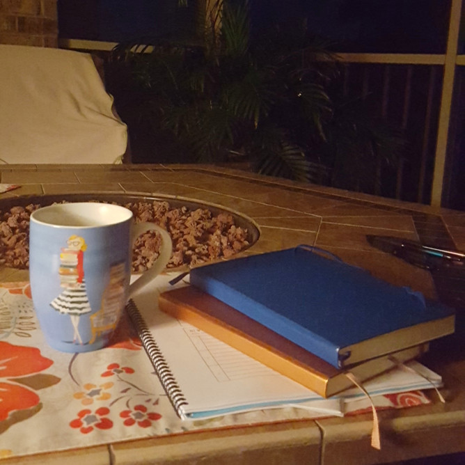 journal and coffee on the porch
