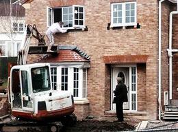 Bad worker balancing using digger bucket