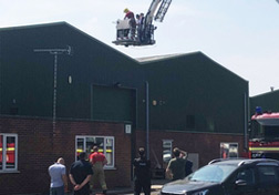 Cherry picker over warehouse