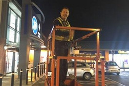 Man using scissor lift