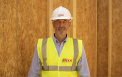 Site manager in protective clothing