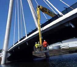 Inspecting under highway bridge