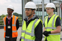 Apprentices in construction workers clothing