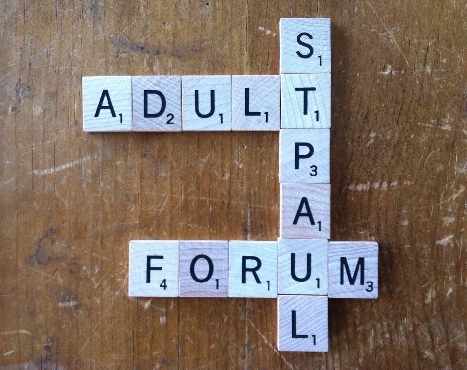St. Paul Adult Forum spelled in Scrabble tiles
