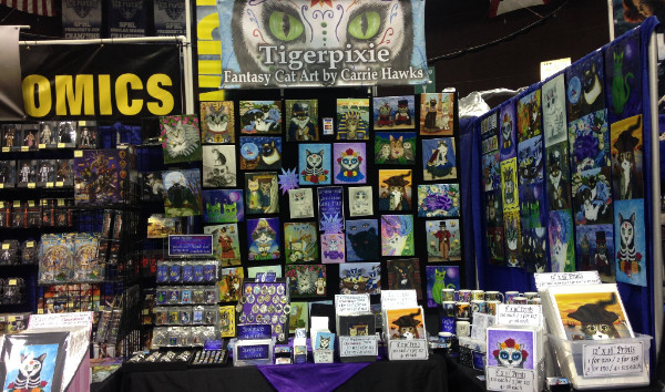 Tigerpixie Fantasy Cat Art by Carrie Hawks Show Booth Display