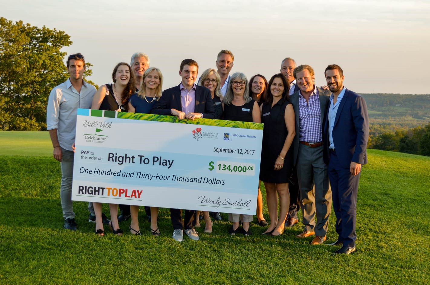 Bill Volk Golf Classic Presenting Cheque to Right To Play