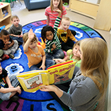 Preschoolers Raising Hands