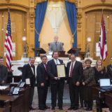 Marching Band honored by State Senators Kevin Bacon and Jim Hughes