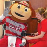 Brutus having blood pressure taken