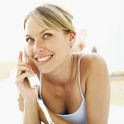 Woman accepting date invitation over phone