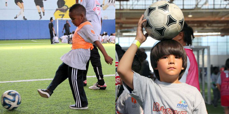 Young participants playing with the soccer ball during KickStart's opening day celebrations.