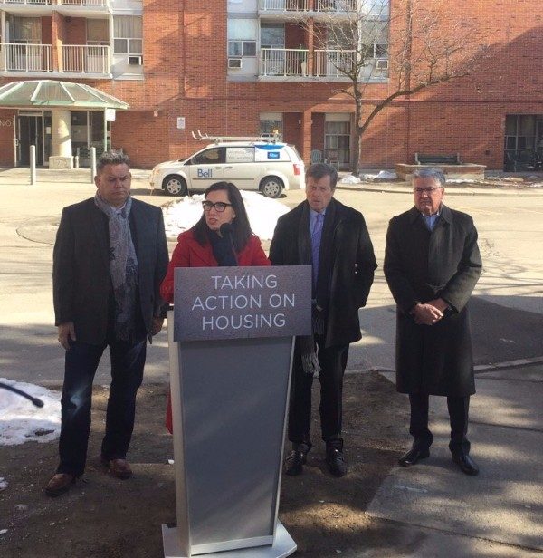 Photo of Councillor Ana Bailão speaking at a press conference held at 100 Cavell Ave and joined by Ward 6 Councillor Mark Grimes (left), Mayor John Tory (centre) and President and CEO (Interim) Greg Spearn.