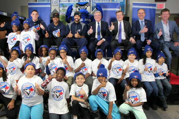 Blue Jays players Aaron Sanchez, Marcus Stroman, Dalton Pompey; President & CEO (Interim) Greg Spearn, Toronto Community Housing; Mayor John Tory; Jays Care Executive Director Robert Witchel; Blue Jays Central Host Jamie Campbell; and Rookie League participants approve of this expansion with smiles.