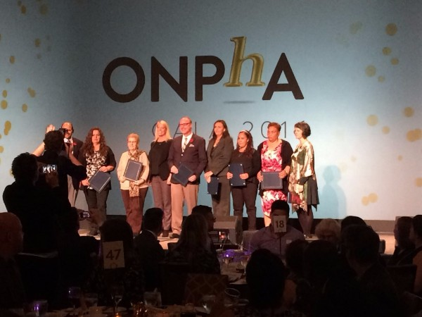 Toronto Community Housing tenants Lorna Colquhoun (second from right), Veronica Marte (third from right) and Penny Fisher (fourth from right) accepted the awards on behalf of their communities.