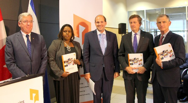 Left to right: President and CEO (Interim) Greg Spearn, Muna Mohammed, Blake Hutcheson, Mayor John Tory and Bud Purves, Chair, Toronto Community Housing Board of Directors holding copies of action plans at the September 10 announcement.