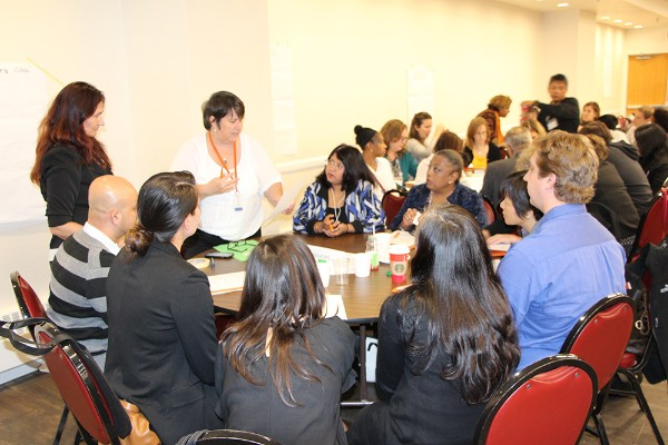 Toronto Community Housing staff and service providers discuss how to address shared challenges and improve the lives of residents.