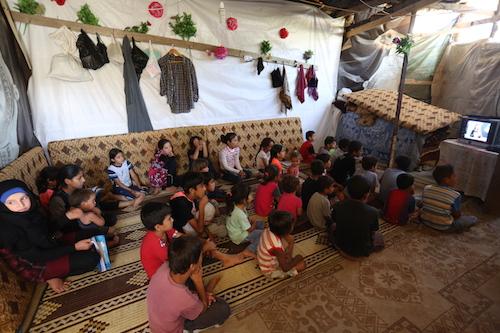 Refugee kids watching My School