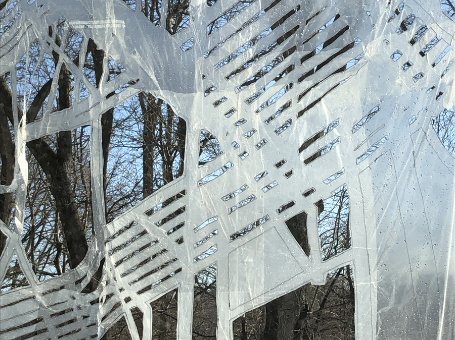 Snowmelt, blue skies, bare trees through the clear plastic lens of Urban Edge/Iron Spine Installation detail © Natalya Khorover Aikens 2019