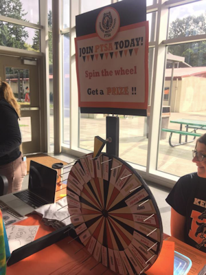 Photograph of Kenmore Middle School PTSA's A membership display featuring a spoked prize wheel.