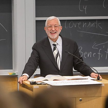 Federal Judge Jed Rakoff at a podium in front of a chalkboard.