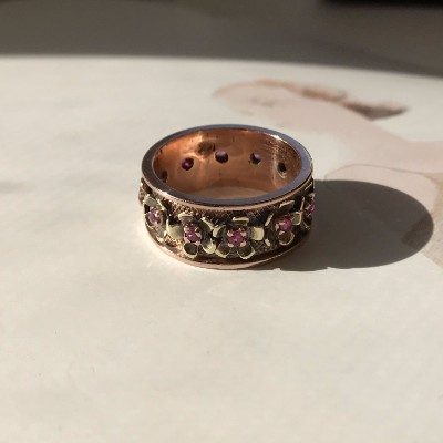 Vintage 14k rose gold cigar band with flowers and .45 carats of rubies