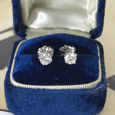 Vintage half carat diamond solitaire stud earrings