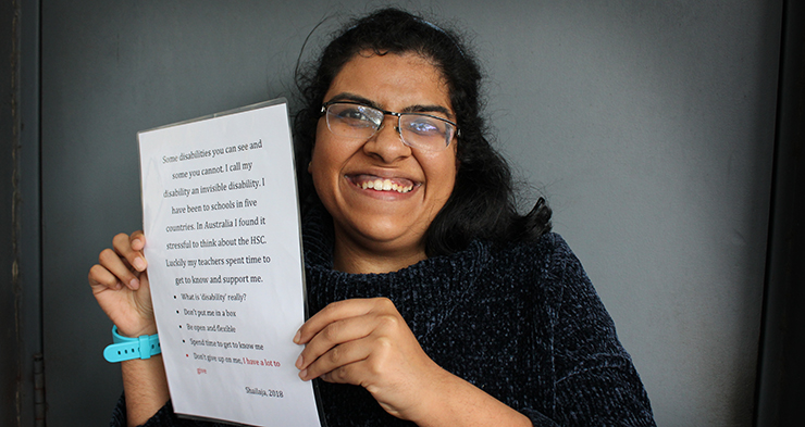 Shailaja holding her inclusion card