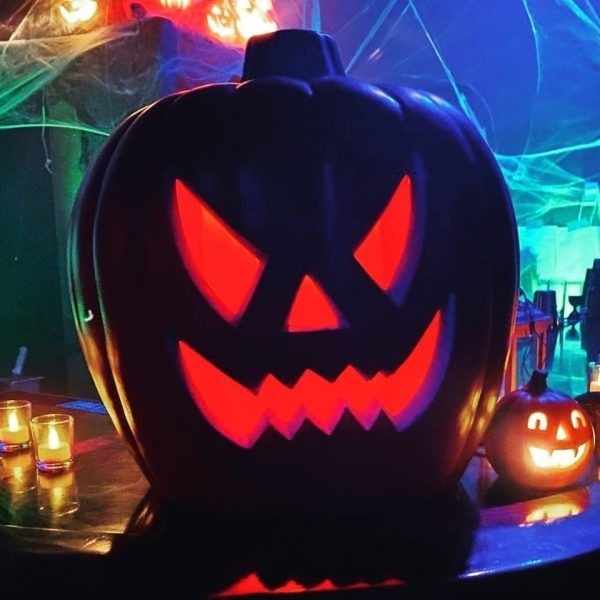 Spooky Jackolantern at the bar at Apparition Spook-easy