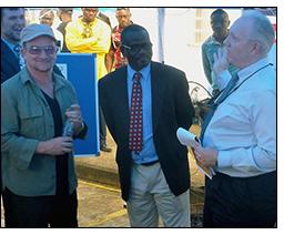 Bono joins U.S. congressional delegation for a Lister engine demonstration.