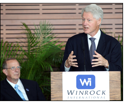 President Bill Clinton speaks as Winrock President Frank Tugwell listens during Winrock's 25th Anniversary event in Little Rock.