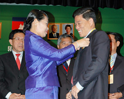 Kosal Chea is awarded a medal of honor