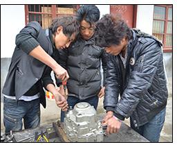 Repairing a motorcycle engine.