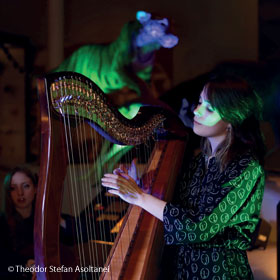 Image of Anna McLuckie playing the harp