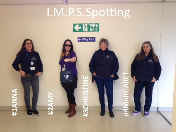 IMPS trainers standing in the Trainspotting pose